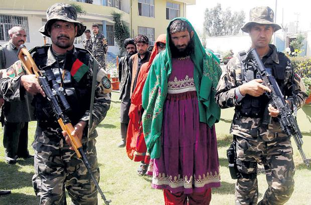Afghan forces arrest armed insurgents who had disguised themselves as women in the eastern province of Laghman this week.