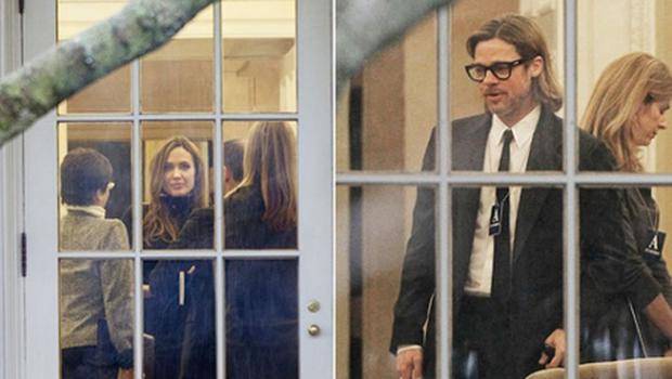 Angelina Jolie and her partner Brad Pitt are seen through the window