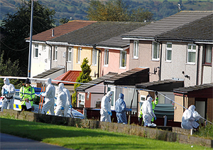 Forensic officers at the scene close to where police constables Fiona Bone, 32, and Nicola Hughes, 23, where killed in Hattersley, Greater Manchester