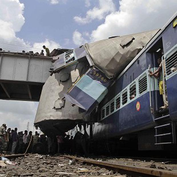 The roof of Uttarbanga Express's passenger car sits on top of Vananchal Express (AP)
