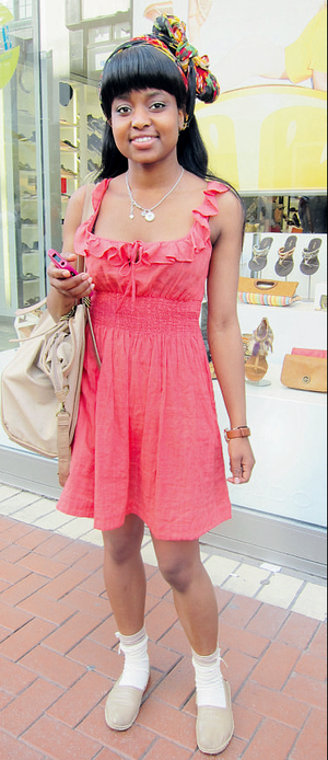 Victoria's printed headscarf and ankle socks add an extra oomph factor to her coral sundress.