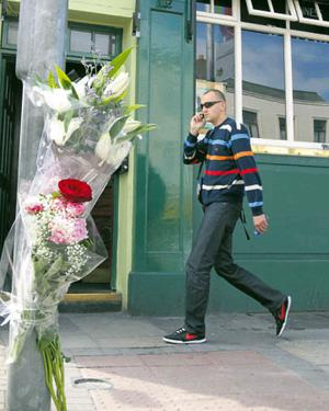 Flowers at the spot on Camden Street, Dublin, were Eugene Moloney was attacked during the early hours of Sunday morning