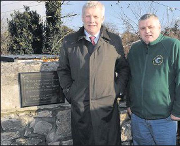Fergus O'dowd TD and Gerry Keenan, Chairperson of the Dee and Glyde Fishing Association at the opening of the White River Enhancement Project.