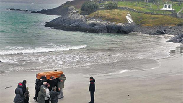 The remains of Una O'Connell are carried across Derrynane strand to Abbey Island cemetery