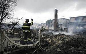 It was across the East River in Breezy Point where Sandy left its most devastating mark. Photo: AP