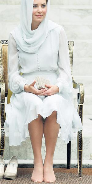 Kate, Britain's Duchess of Cambridge, moments after removing her shoes before entering As-Syakirin mosque in Kuala Lumpur yesterday