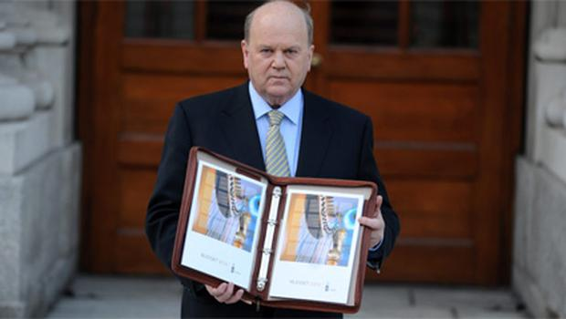 Finance Minister Michael Noonan presenting the budget for 2012 in December