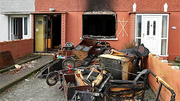 John Keane's house was torched following a New Year's Eve kiss