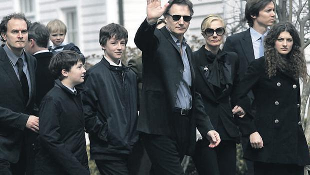 Liam Neeson and his two sons Micheal and Daniel at the funeral of his wife Natasha
