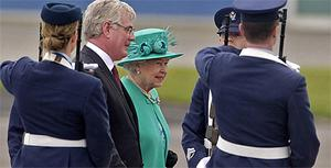 Queen Elizabeth II was greeted by Tanaiste Eamon Gilmore upon arrival at Casement Aerodrom. Photo: PA