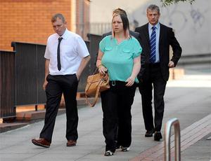 Neil and Joanne Wightman (left and centre), parents of six year old Owen Wightman, arrive at Leeds Crown Court. Photo: PA