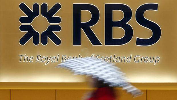 RBS said it remained in the red last year, but revealed sharply reduced losses of £1.1bn against £3.6bn a year earlier. Photo: PA