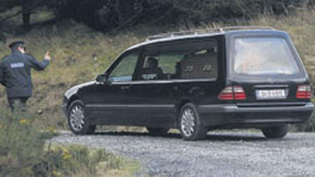 a hearse removing her remains in the Wicklow Mountains