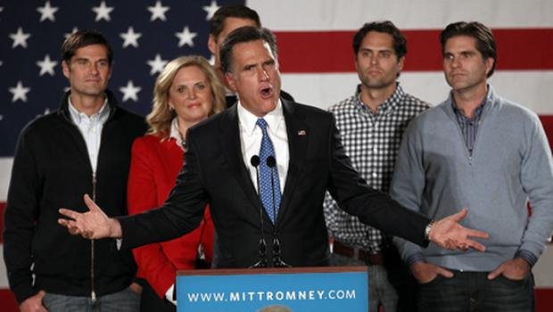 Mitt Romney, speaks as his wife Ann Romney and their sons (L-R) Josh, Matt, Craig and Tagg look on at the Hotel Fort Des Moines on the night of the Iowa Caucuses. Photo: Getty Images