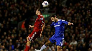 Andy Carroll out-jumps Chelsea's Branislav Ivanovic