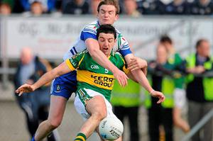 Kerry's Aidan O'Mahony is tackled by Monaghan's Dessie Mone. Photo: Ray McManus / Sportsfile