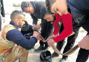 Members of the Free Syrian Army check ammunition in al-Bayada district in Homs yesterday