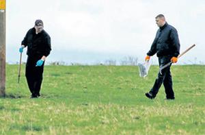 Gardai searching fields adjacent to the house