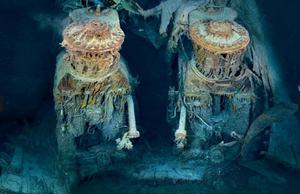 """Two of Titanic's engines lie exposed in a gaping cross section of the stern. Draped in """"rusticles""""—orange stalactites created by iron-eating bacteria—these massive structures, four stories tall, once powered the largest moving man-made object on Earth."""