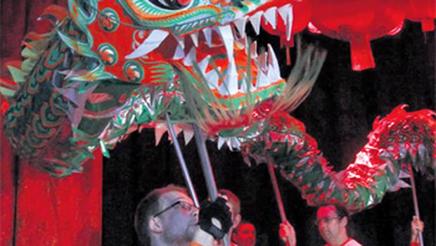 Artists perform with a dragon to celebrate Chinese New Year in Meeting House Square in Dublin