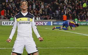 Glory night: Fernando Torres delights in scoring at the Nou Camp