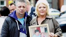 Victims parents Freddy and Terry Mills holding a photo of their son Keith and his daughter as they left court