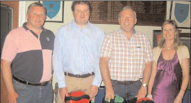 Eddie Finn, left, organiser of the golf classic in aid of Baltydaniel National School, with winners Denis Barrett. Philip Comyn and Una Kingston, school principal.