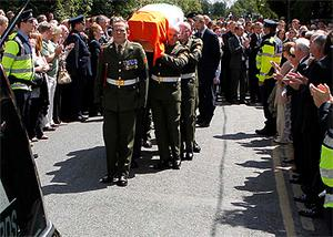 The Tricolour covered coffin carrying the remains of the late Brian Lenihan leaving St Mochta's Church, Porterstown, this morning for burial. Photo: Kyran O'Brien