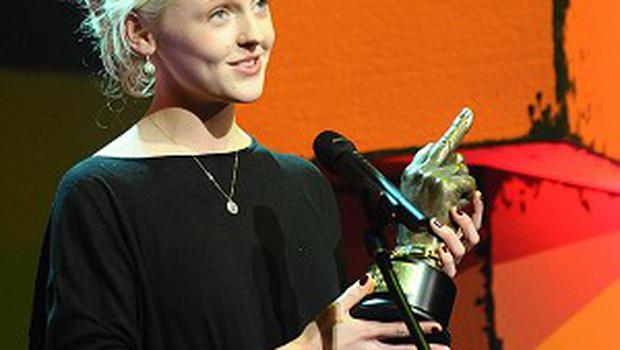 Laura Marling collects the Best Solo Artist award on stage during the 2011 NME Awards at the O2 Academy Brixton, London