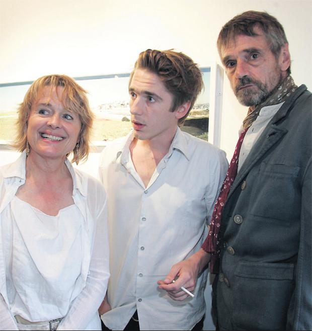 Sinead Cusack is pictured with son Sam Irons and actor husband Jeremy Irons at Sam's photographic exhibition