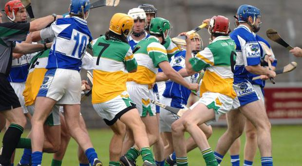 Laois and Offaly players clash shortly after the throw-in at O'Connor Park in Tullamore yesterday.