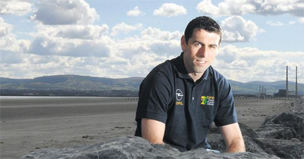 Dublin's David Henry takes time out to relax at Dollymount Strand during the week