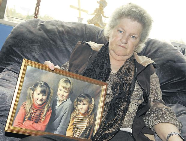 Ann Boyle pictured in March around the 30th anniversary of the disappearance of her daughter Mary. Ann is holding a photo of her three children Mary, Paddy and Ann
