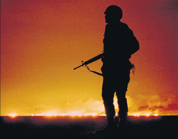 A US soldier guards a flaming oil well in Kuwait in 1991. Crude oil has been at the centre of international thinking ever since