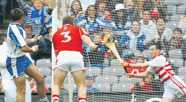 "Dan Shanahan beats Cork full-back Diarmuid O'Sullivan and goalkeeper Donal Ã""g Cusack to score his first goal during yesterday's All-Ireland quarter-final replay at Croke Park"