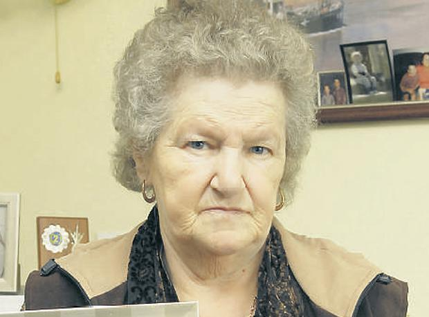 Ann Boyle with pictures of her missing daughter Mary