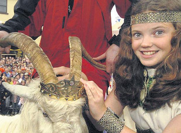 Crowned by 12-year-old Caoimhe O'Sullivan from Sun Hill, Killorglin, King Jimmy's silken locks glistened with raindropsfor the start of the three-day festival