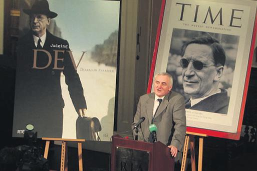 Bertie Ahern launched Judging Dev in Dublin yesterday flanked by two huge portraits of the man. Below: Eamon de Valera meets Winston Churchill in one of the historical photos from the new book