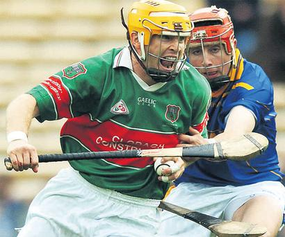 Paul Ormonde of Loughmore Castleiney, shows his determination during theT ipperary SHC against Final Eric Woodlock of Drom Inch
