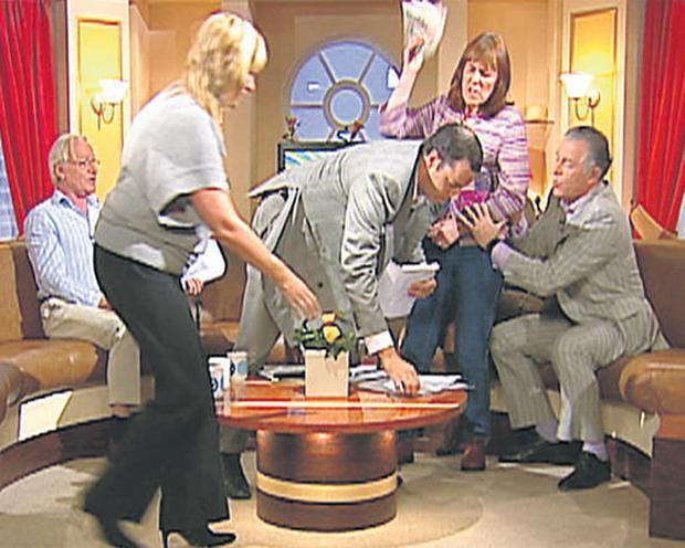 Ireland AM presenter Mark Cagney restrains guest Kathy O'Beirne as chaos erupts in the TV3 studios