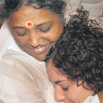 Mother Amma spreads comfort with a heart-warming hug