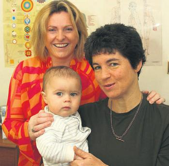 Aisling Killoran (left) with patient Michele O'Briain and Michele's son Cillian Penston, aged 10 months