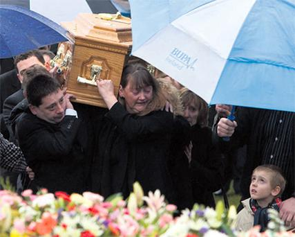 Young Jamie Campbell watches as friends and relatives of his mother, Ciara Campbell (22), carry her coffin from the Church of the Holy Cross in Myshall, Co Carlow