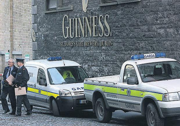 Gardai outside the Guinness brewery in Dublin yesterday following the theft of 450 kegs of beer and stout