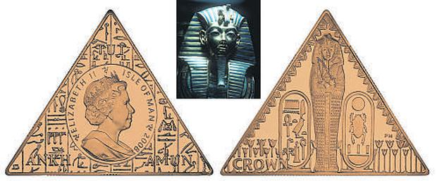 The three-sided coins marking the London exhibition of the treasures of boy-king Tutankhamun