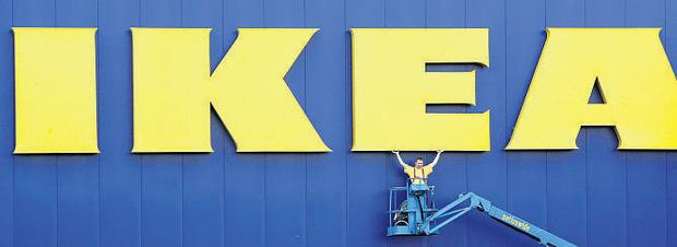 Paul Reid, manager of the new IKEA store, celebrates the opening of the IKEA branch in Belfast,The store has the largest sales floor of any IKEA branch in the UK and will have over 9000 products