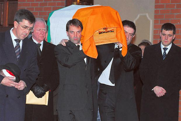 Among the mourners at the removal of Gene Fitzgerald in Wilton, Cork last night were Taoiseach Bertie Ahern and Michael McGrath TD and Enterprise Minister Micheal Martin and Ceann Comhairle John O'Donoghue