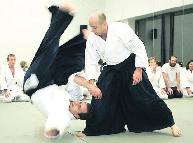 Head first: Aikido master Cyril Lagrasta demonstrates the power of the martial art