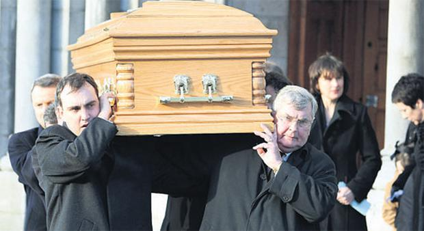 Ray MacSharry and son Senator Marc MacSharry lead the pallbearers at yesterday's funeral