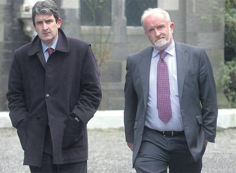 Solicitors Sean Acton, left, and Michael McDarby leave the Disciplinary Tribunal